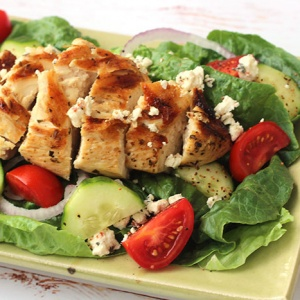 Greek Salad with Chicken on a platter