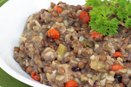 Turkey lentil soup in white bowl