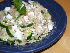 Zucchini Orzo Salad with Mint in a blue bowl