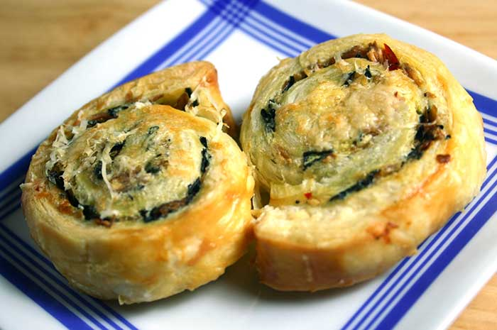 Two Spicy Mushroom pinwheels on a square plate