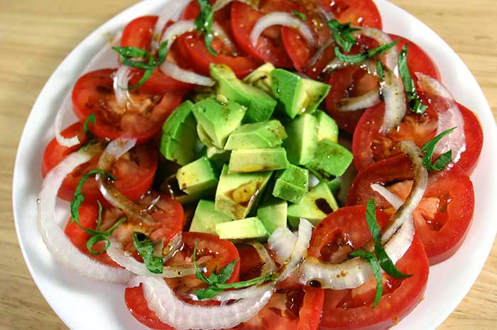 Tomato Avocado Salad with Berry Orange Vinaigrette