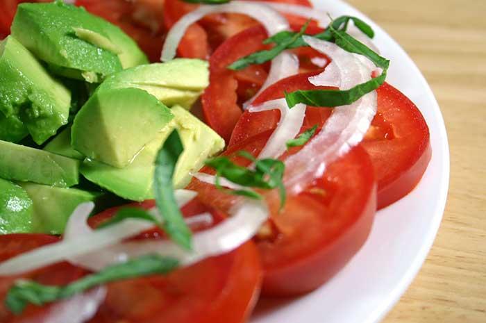 Tomato Avocado Salad with Berry-Orange Vinaigrette