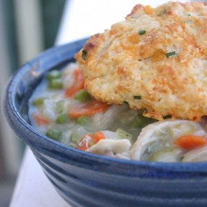 Diabetic Chicken Pot Pie topped with a Cheddar-Chive Biscuit in a blue bowl