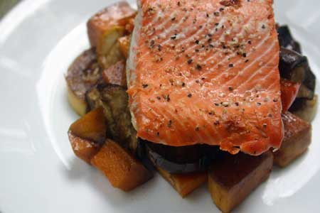 Baked Salmon with Roasted Vegetables on a white plate
