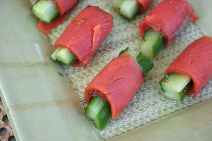 the salmon and julienne the cucumber, make sure your strips of salmon ...