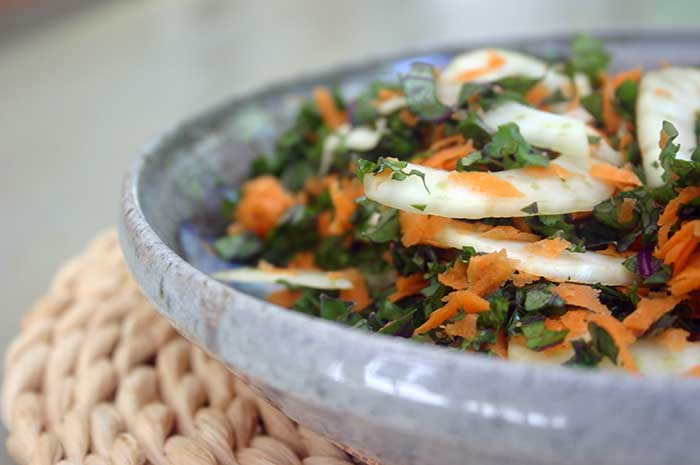 Close-up of Fennel and Kale Slaw in a blue bowl
