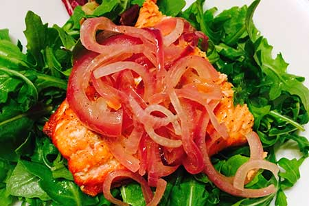 Broiled Salmon with Onion Marmalade over Greens