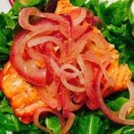 Salmon with Onion Marmalade over Greens