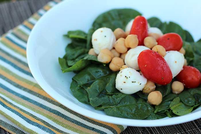 Close-up of Mozzarella, Tomato, and Chickpea Salad in a white bowl