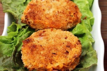 Sweet Potato Cakes with Ham on a bed of lettuce on a white serving platter
