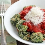 Spinach dumplings with tomato sauce and parmesan