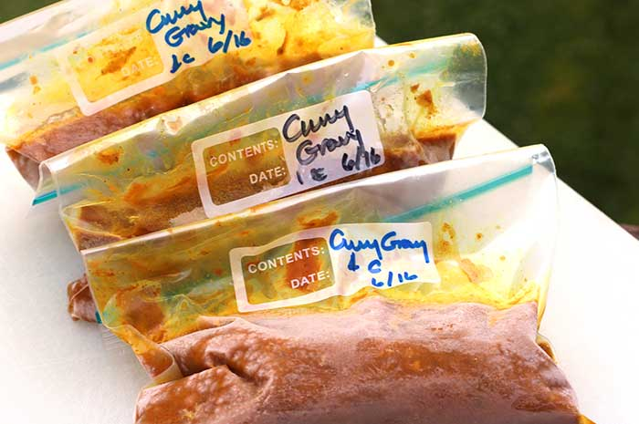 Make-Ahead Curry Sauce in plastic gallon bags labeled with the date