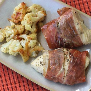 One-Pan Prosciutto-Wrapped Chicken with Roasted Cauliflower