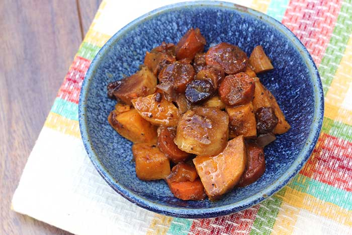 Balsamic Root Vegetables made in the slow cooker and served in a blue bowl