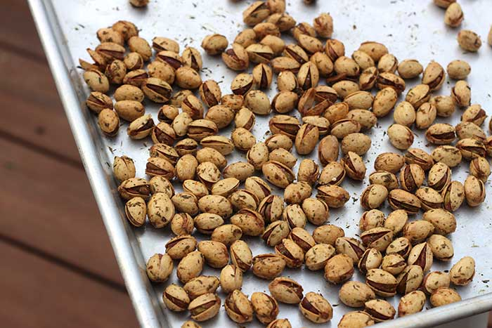 Roasted pistachios on a baking pan