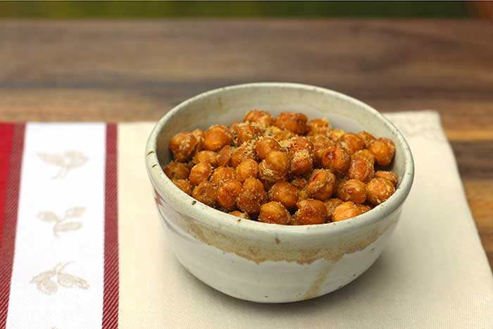 Crispy Roasted Chickpeas with Parmesan Cheese in a ramekin on a cloth napkin
