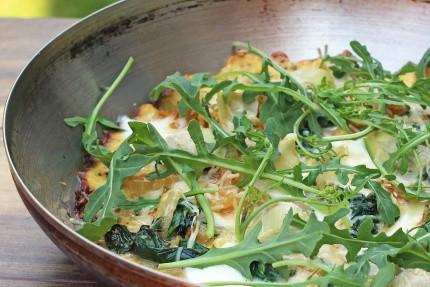 Spinach Artichoke Pizza with Cauliflower Crust in a metal serving dish
