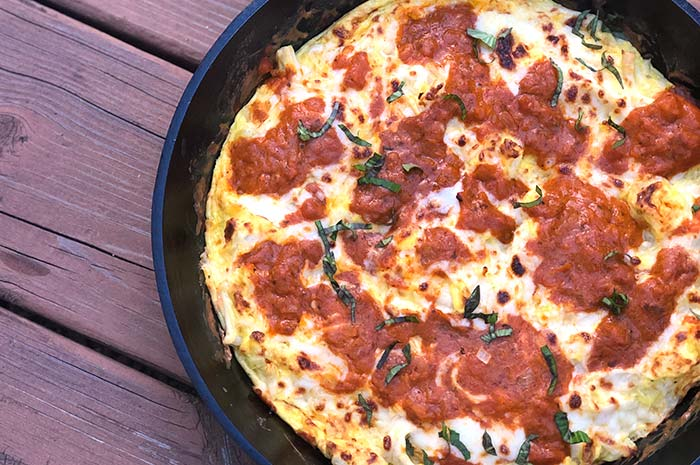 Pizza Frittata in a dish on a wooden table, as seen from above