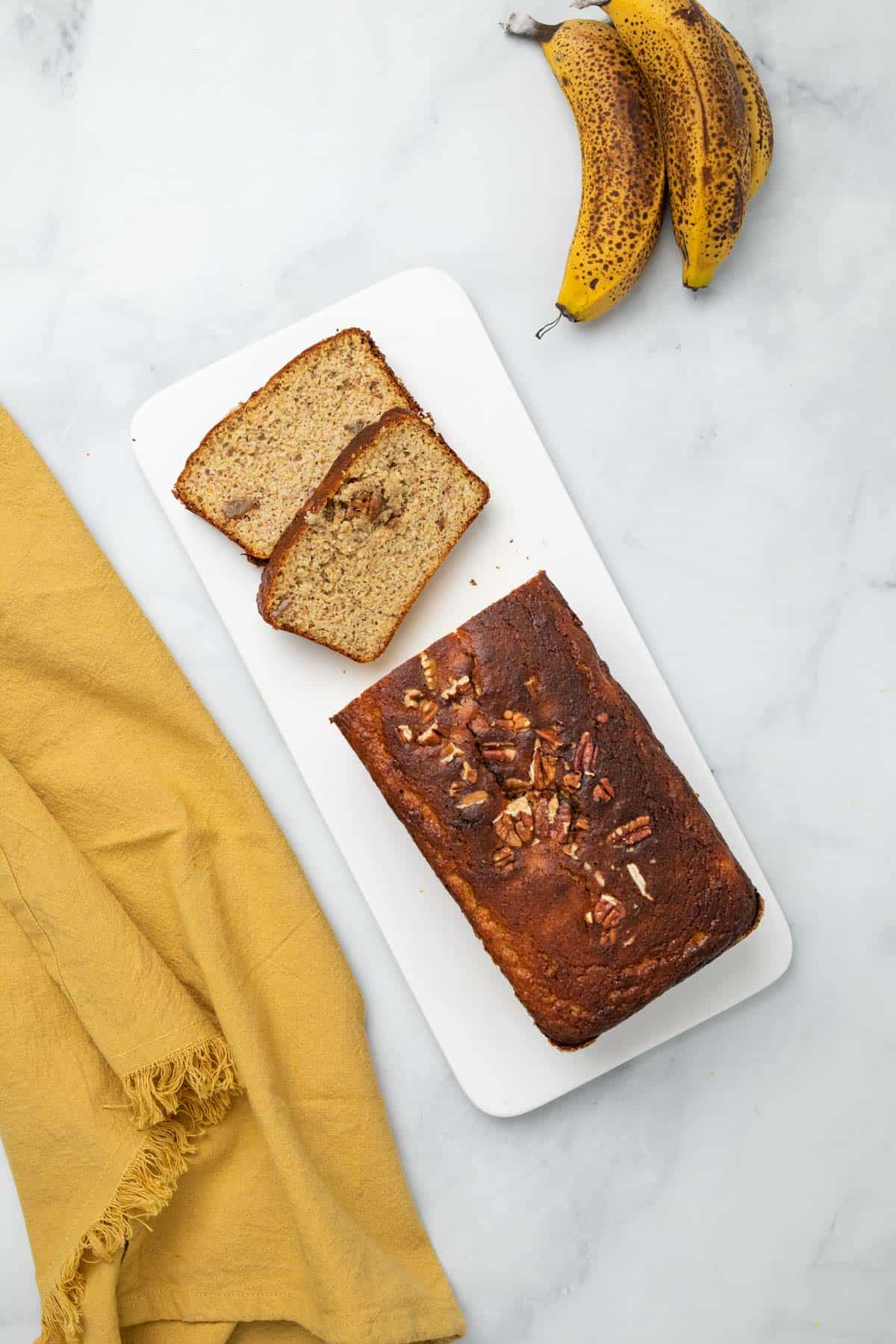 Low-carb banana bread loaf with two slices cut
