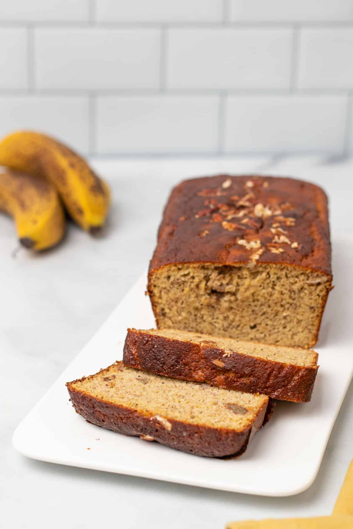 Loaf of banana bread with 2 slices cut