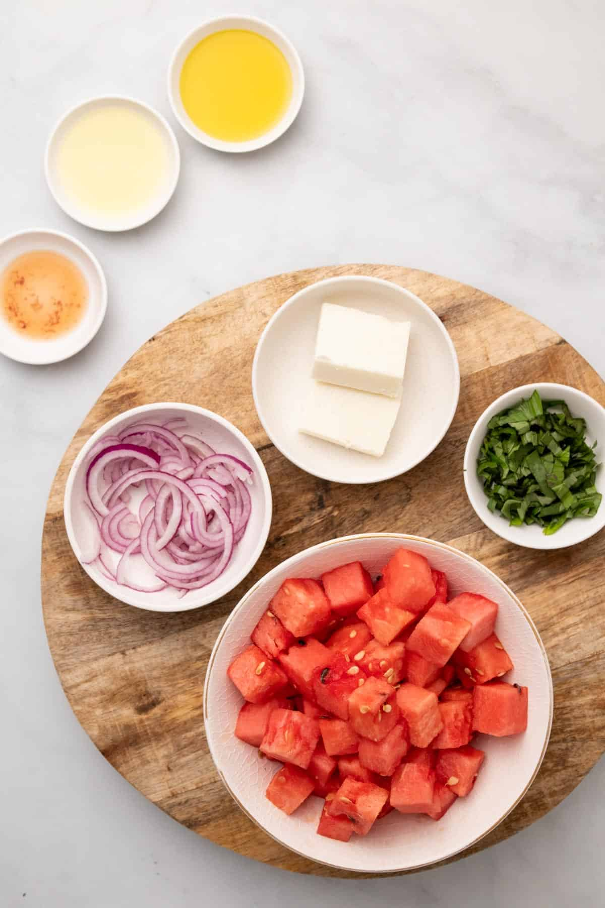 Salad ingredients in separate ramekins, as seen from above