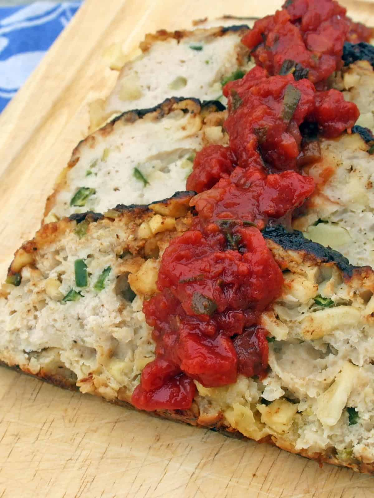Chicken Apple Meatloaf cut into slices on a wooden cutting board
