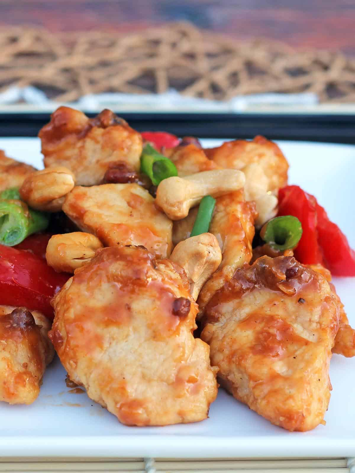 Kung Pao Chicken with Cashews on a white plate