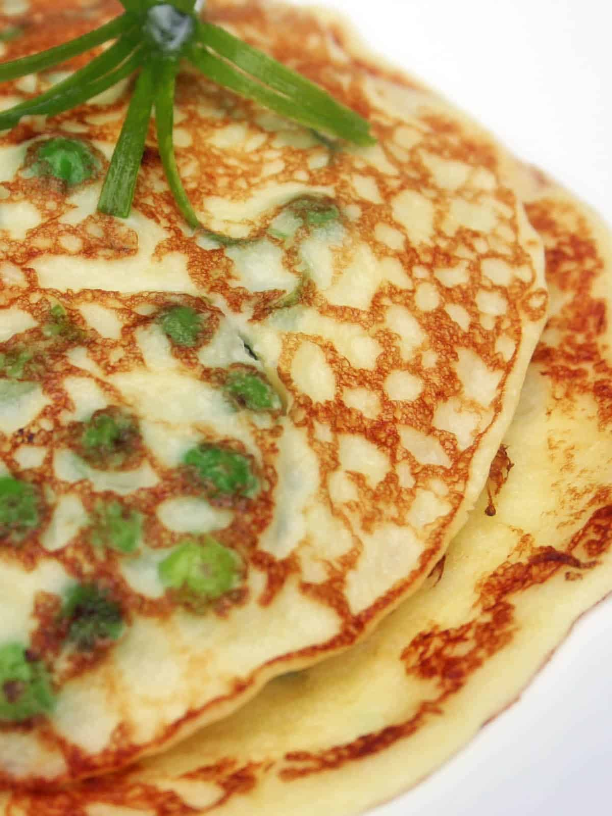 Stack of Pea Pancakes on a white plate