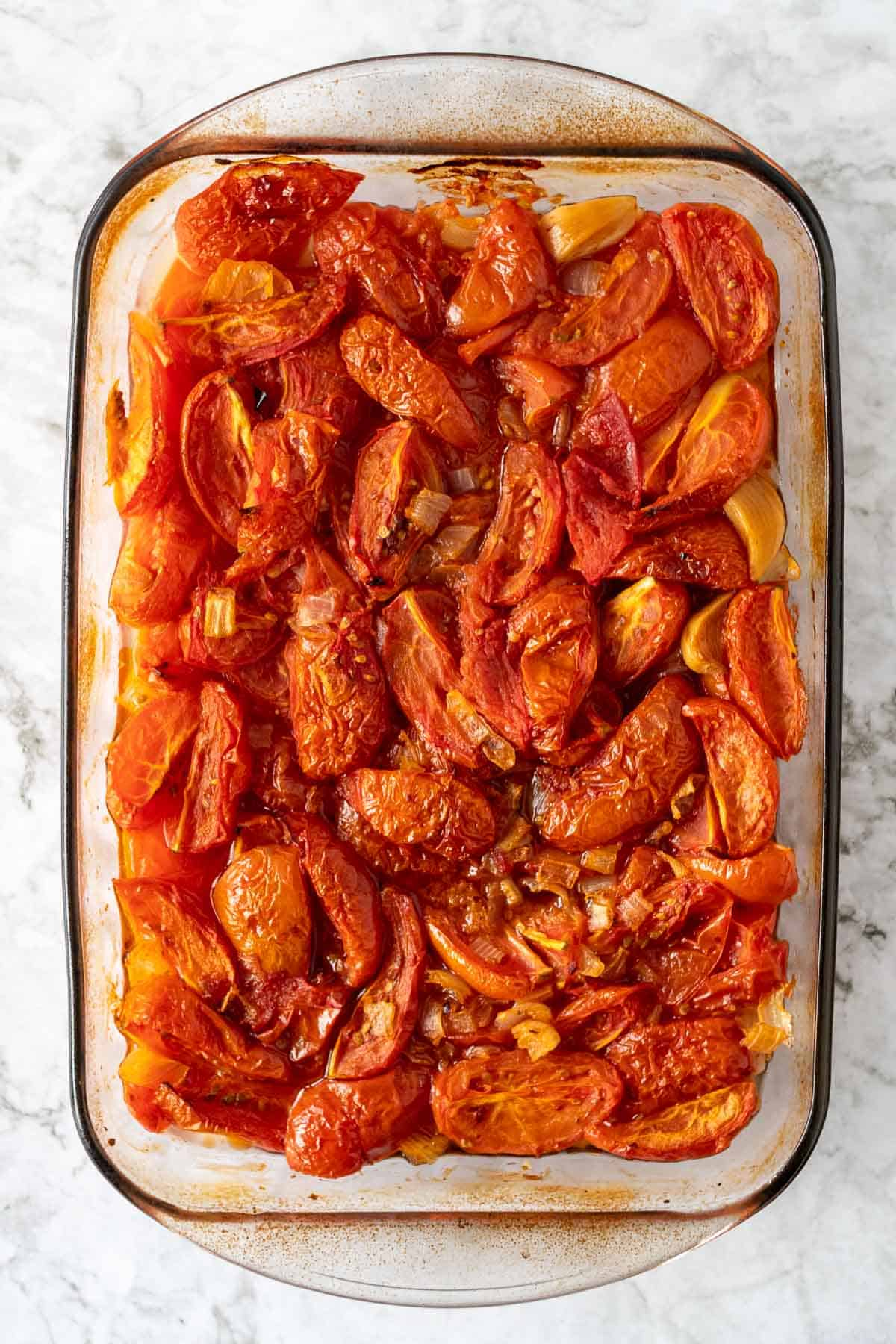 Roasted tomatoes in a glass baking pan