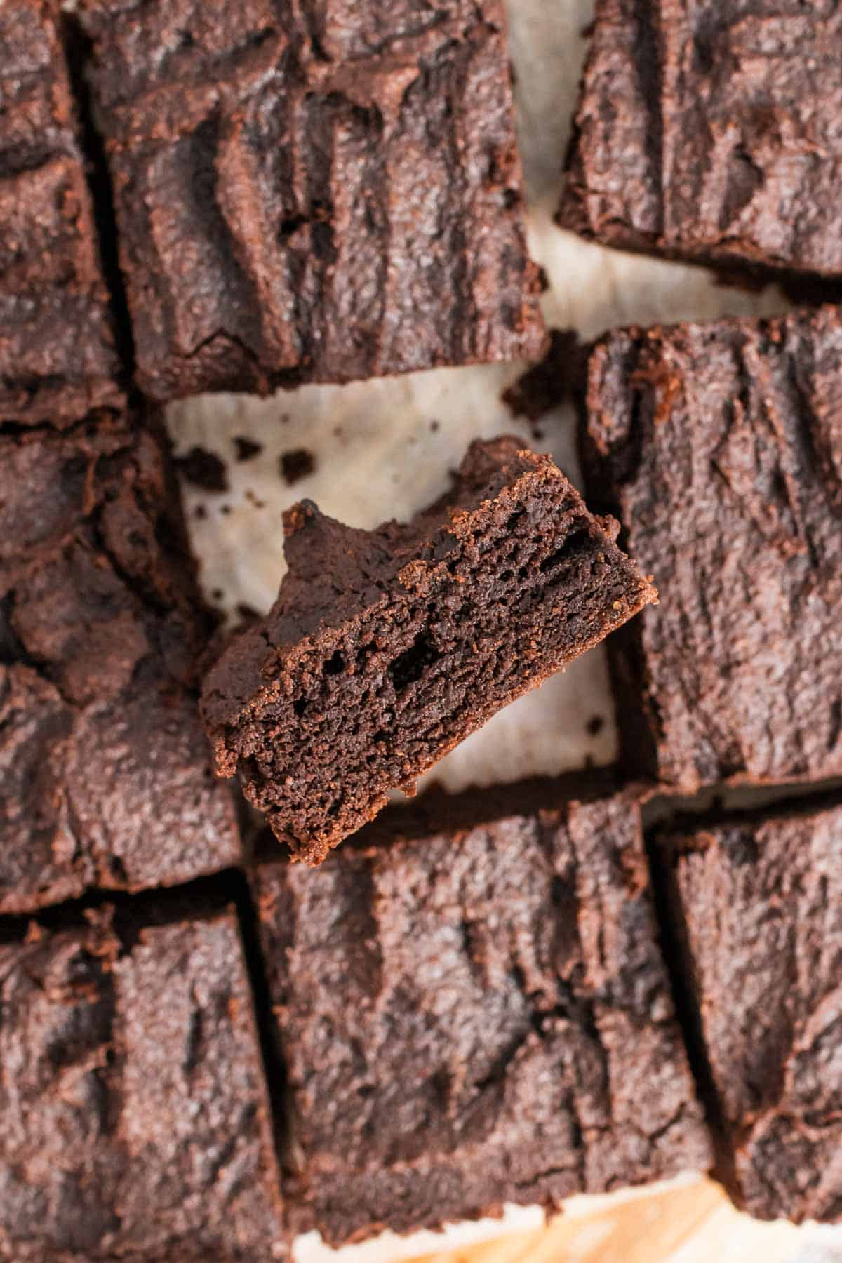 Overhead view of brownie slices with one brownie turned on it's side to show the texture