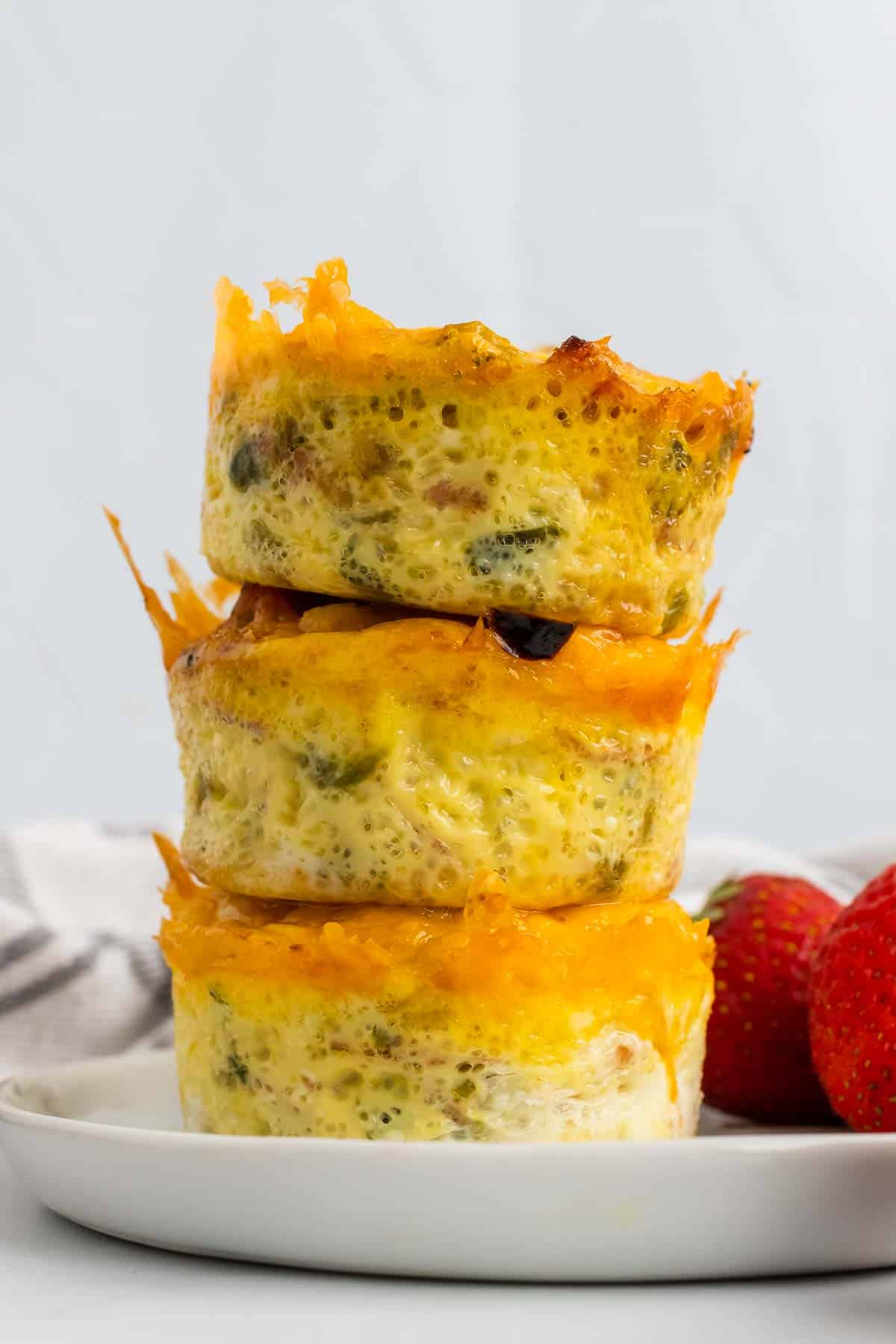 Stack of three egg muffins seen from the side
