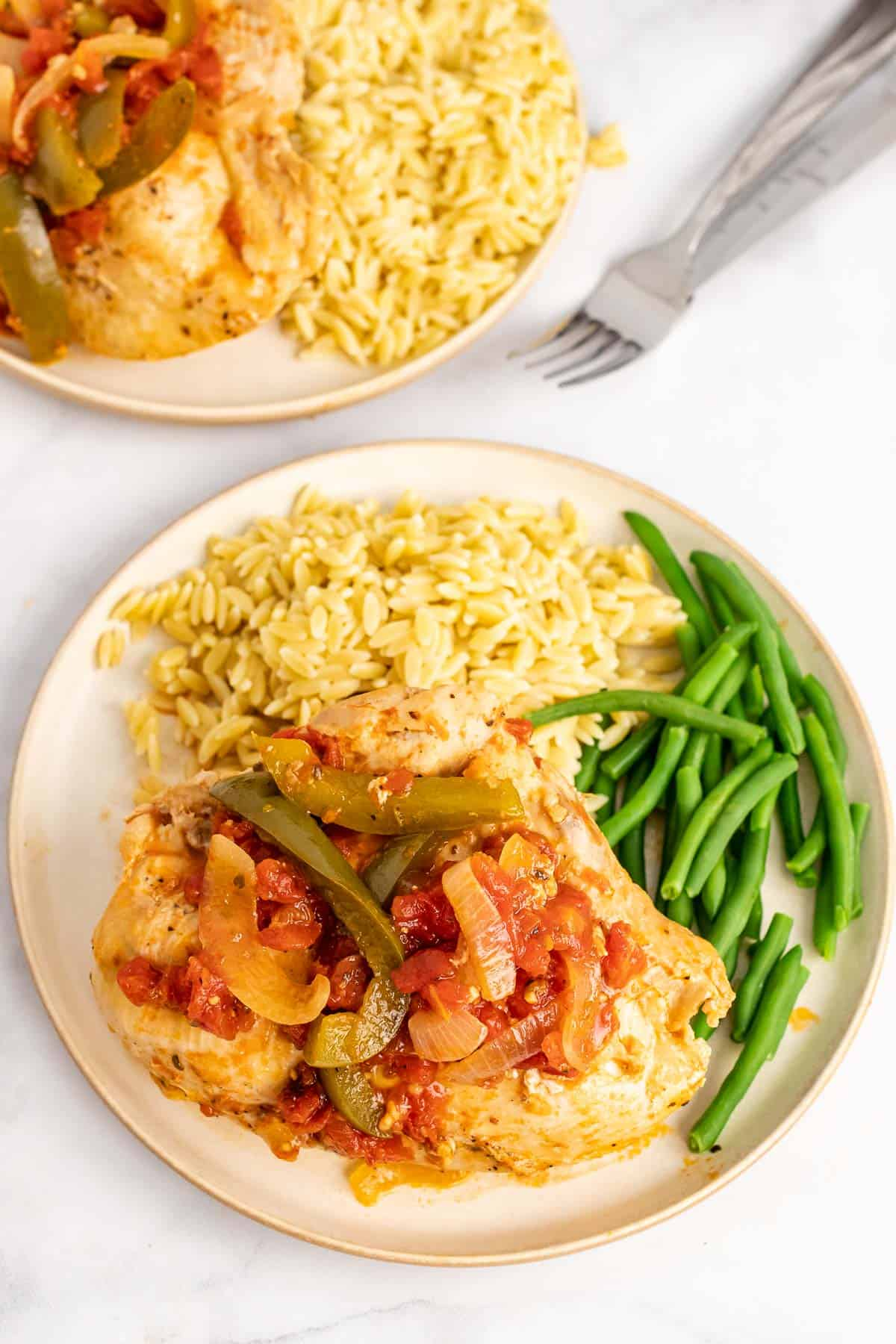 Plate of Chicken Cacciatore with orzo and green beans