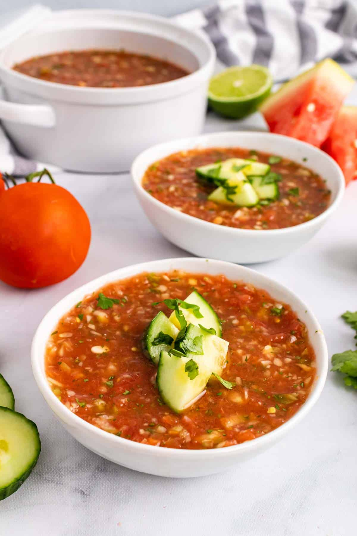 Two bowls of Grilled Watermelon Gazpacho on table