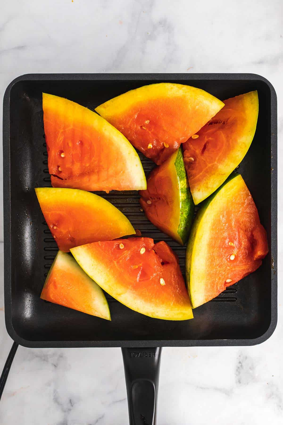 Watermelon slices on a grill pan