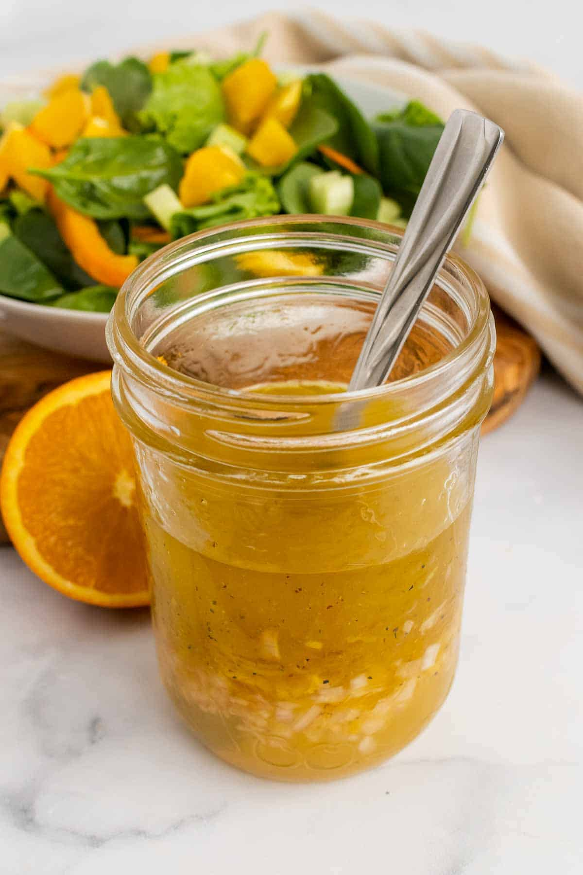 Glass jar with citrus vinaigrette