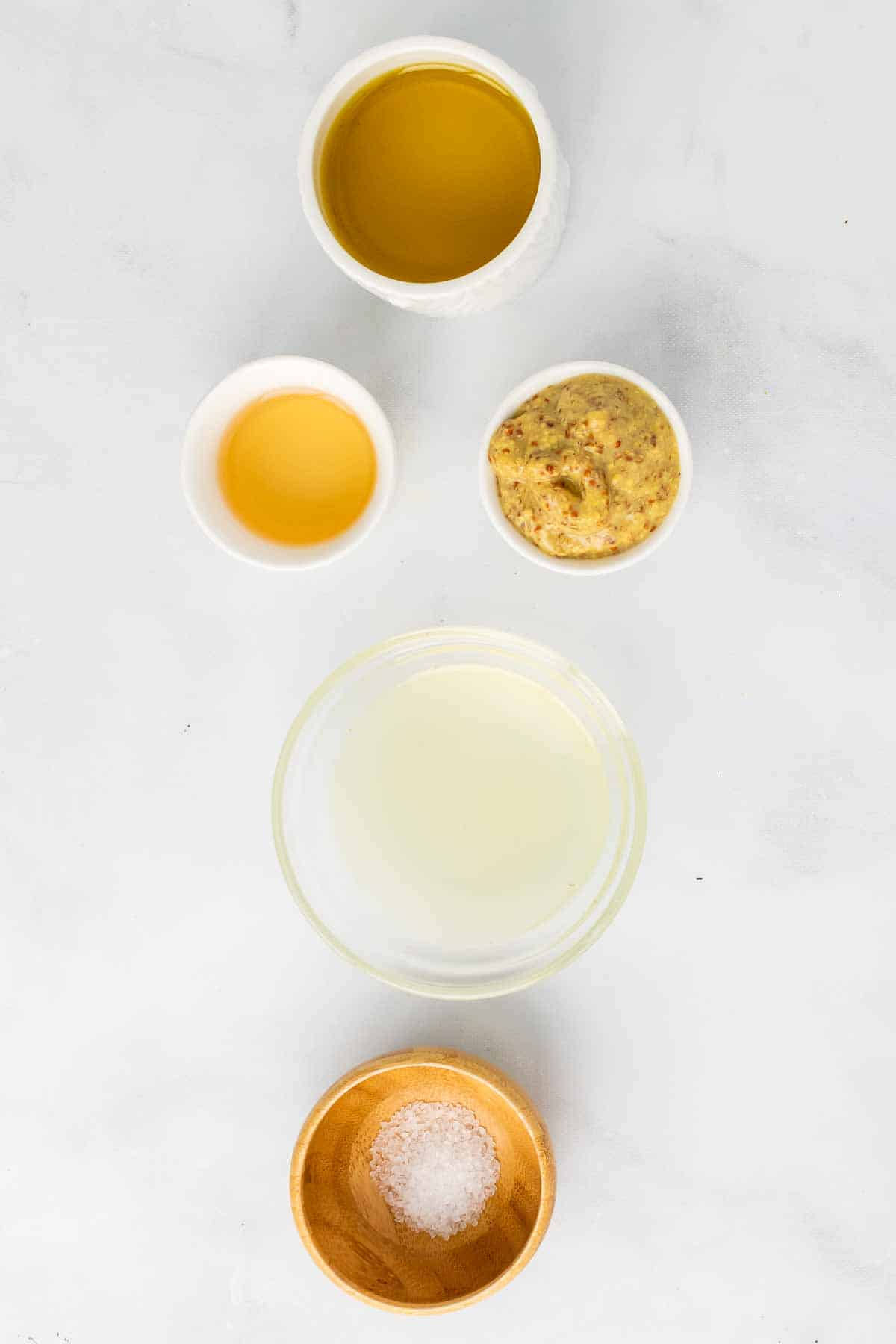Ingredients for the vinaigrette on a marble surface