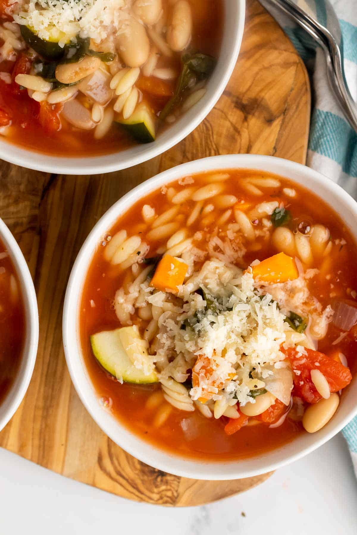 Bowl of slow cooker minestrone with grated cheese on top