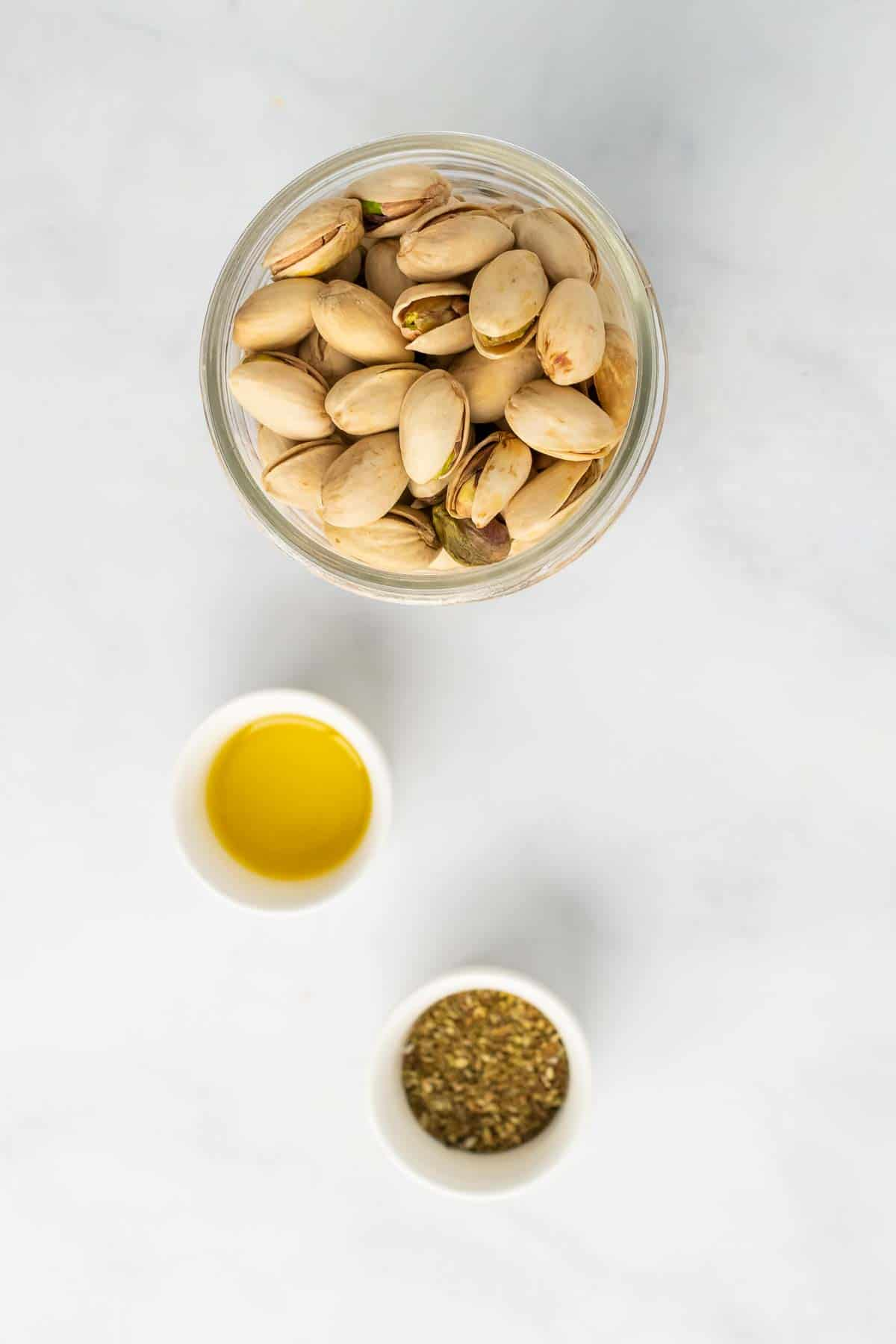 Pistachios, oil, and spices in individual ramekins