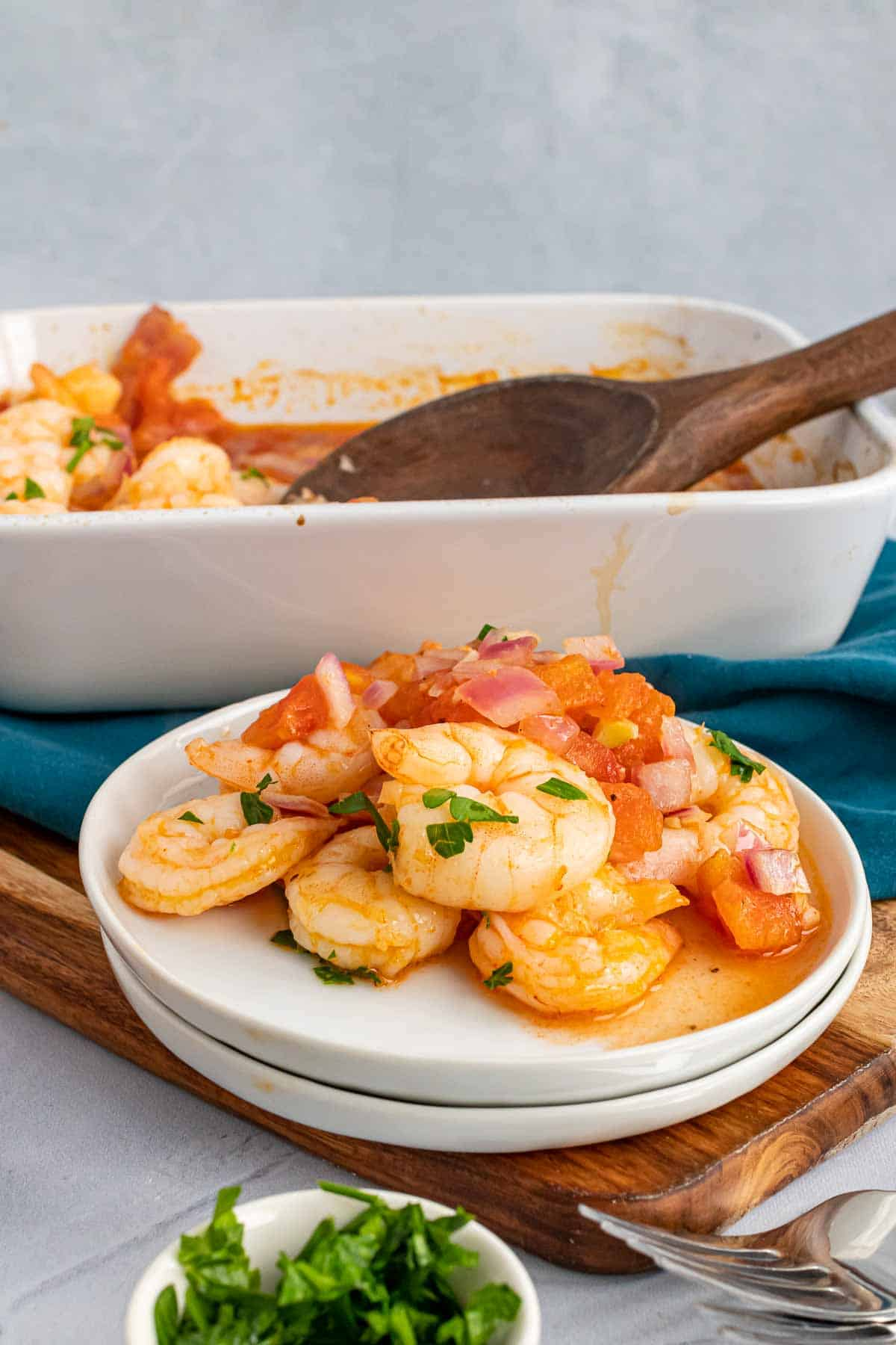 Plate of shrimp in front of the baking dish